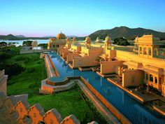 Oberoi Udaivilas, India. Conceived as a traditional Indian palace. I think I'll stay in the pool all day, enjoying the natural splendor.