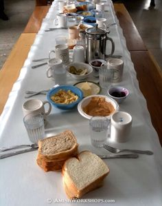 I enjoyed a wonderful lunch like this in an Amish home during a quilting gathering in lower Michigan. The tables extend h-u-g-e and benches are pulled up.