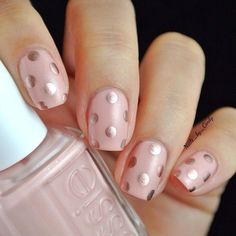 Pink nail polish & rose gold polka dots — feminine and playful nail art.
