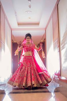 Bride in Pink and Gold Bridal Lehenga with Kaleere