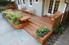 Redwood decking-benches and planters built by deck contractor M Bulilders