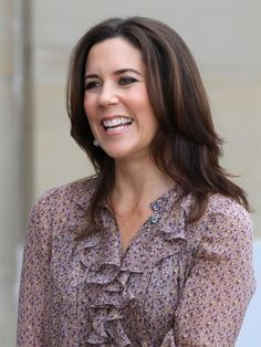 Crown Princess Mary of Denmark just outside Frederick VIII's palace while talking to the Danish media during Prince Christian's first day at the public school
