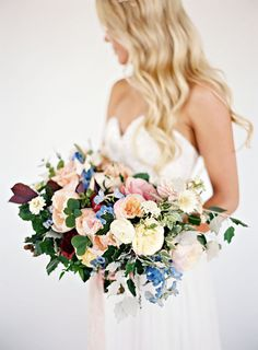 Martha Stewart Wedding has combined 52 beautiful spring wedding bouquets for your wedding day. Whether you like pinks, reds, blues, white, greens, or earth tones - each of these bouquets will give you inspiration to find the perfect bouquet. #Wedding #Bouquets #Spring #Weddings #Ideas #SpringWedding #SpringFlowers #WeddingFlowers #SPringWeddingBouquet | Martha Stewart Weddings - 52 Ideas for Your Spring Wedding Bouquet