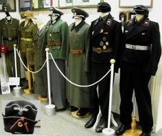 German World War II uniforms at the Celler Garrison Museum in Celle. One of the black panzer uniform caps has an authentic bullet hole in it - from 1943 in Russia. The man who wore this cap during World War II was in the spring of 2009 still working for the Celler Garrison Museum.