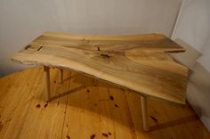 Hand made coffee table with a rare piece of locally sourced, solid English Walnut as the table top with European Beech legs and an English Oak frame. The table tops edges have been left with the natural look of the tree it came from, this combined with the interesting grain pattern and