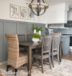 Using white home accessories against dark wood in a small modern farmhouse dining room. #modernfarmhouse #boardandbatten #diningroomdecoratingideas #graydiningroom