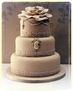 i like this idea - but modified --no cameo and maybe not the flower on top --something else. but it's a beautiful design.   #Cameo #Wedding #Cake!!http://www.simplyelegantforyou.com/