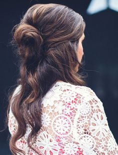 A Low Half-Bun But if you're not ready to fully commit just yet, try a half-bun back on the crown of your head.