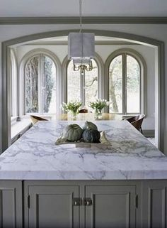 Marble island with olive grey cabinet