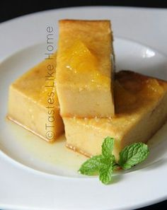 Breadfruit pudding with Orange syrup. Made with overripe breadfruit. When your breadfruit becomes too soft to cut. Breadfruit pudding with Orange syrup. Made with overripe breadfruit. When your breadfruit becomes too soft to cut. Jamaican Desserts, Jamaican Recipes, Jamaican Cuisine, Pudding Recipes, Cake Recipes, Dessert Recipes, Breadfruit Recipes, Trini Food, Caribbean Recipes