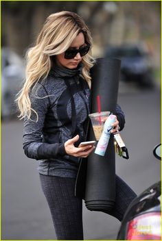 Ashley Tisdale juggles quite a few items in her hands while leaving her yoga class in Los Anegles on Monday afternoon (January 12).