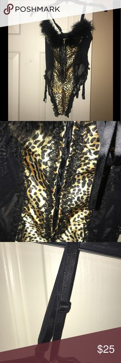 Worn 1x❤️FREDERICK'S❤️ Faux Fur Lingerie WORN 1x❤️FREDERICK'S of HOLLYWOOD❤️Leopard Faux Fur  One Piece thong Body suit with Garters. . Size - 36. Polyester / Lycra. Adjustable straps Frederick's of Hollywood Intimates & Sleepwear
