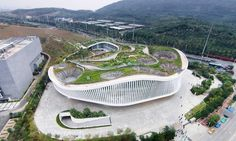 The green roof of the new Nanning Planning Exhibition Hall in China is an elevated urban park that that brings institutional architecture back to the people. Designed by Zhubo Design Zstudio, the building acts as an artificial mountain that expands the existing park and a new public space for city dwellers.