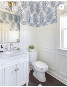 Powder Room Design Ideas in this Makeover Reveal, featuring picture frame moulding and blue palm wallpaper. Gorgeous bright & airy powder bathroom reveal makeover with blue & white palm frond wallpaper, silver faucet, golden mirror. Coastal Powder Room, Blue Powder Rooms, Modern Powder Rooms, Powder Room Decor, Powder Room Design, Powder Room Lighting, Palm Wallpaper, Powder Room Wallpaper, Coastal Wallpaper