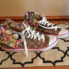 Coach multicolor high top bonneys Multicolor high top sneakers. Most comfortable shoe ever!!! Only worn a few times. I just have too many of them trying to downsize. Normal wear and tear as seen in pics. Fold down to see the multicolor or wear up and tie! Super trendy! Coach Shoes Sneakers