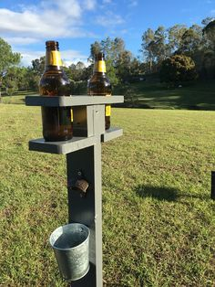 A beer drinks stand with bottle opener and cap holder. The essential item for a backyard golf course