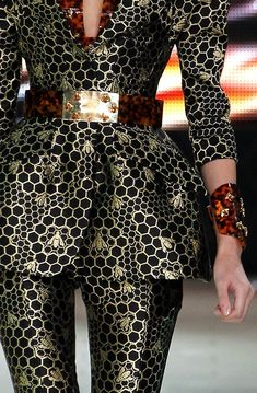 Alexander McQueen bee print peplum jacket and pant suit with tortoise print belt and accessory