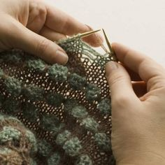 """This explains the method of knitting for """"pop spots""""-- they are not bobbles. Instead, this involves dropping stitches and then bundling several laddered threads together. Clever!"""