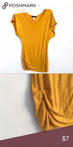 Mustard Yellow Top Short sleeve mustard yellow top. Slight piling. 579 Tops Tees - Short Sleeve