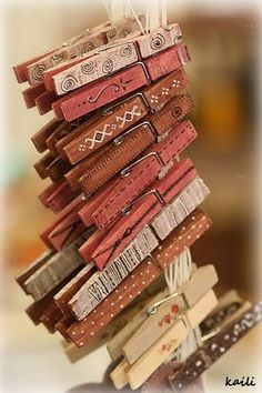 painted clothespins... think these would be cute with magnets on the back for the fridge