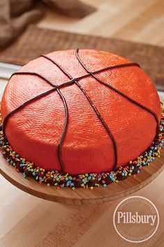 All-Star Basketball Cake from Pillsbury® Baking. Pat frosting with a paper towel to create the texture of a basketball—score! #GoBold