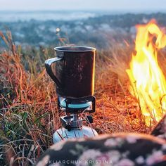 Warming body and soul, camping fire coffee by @kristinka_skl
