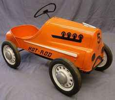 1956 garton pedal car | 38-01.jpg.  I had one just like this.  Looking to buy one and restore but not much luck in locating one.  They made newer models that were Yellow but really want one of the early orange color ones.