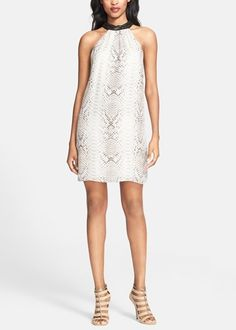 Hot for summer! Can't get enough of this white and black Haute Hippie snakeskin print shift dress.