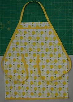 """Dishtowel aprons for the girls - I made these a lot shorter by cutting off 6"""" at the bottom and then sewing it back on to make a row of pockets.  Now the girls don't trip over their adorable aprons. :)"""