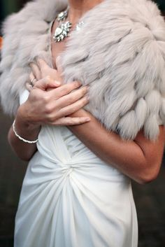 Faux fur bridal wrap to keep you nice and cozy during a chilly winter wedding (and looking so glam of course)