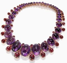 Pink gold, cabochon-cut amethysts, cabochon garnets, tourmalines, pink sapphires and  brown diamonds.