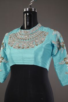 Featuring a fabulous design, this raw silk sky and aqua blue blouse is a stunning piece to own. Check the link for more details - mysoresareeudyog.com  Product Code: 2551704
