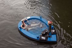 The HotTug... yes, it's a hot tub, in a boat, with a woodstove heater. Yes, it's real. And really expensive. No kidding.