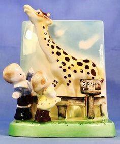 Giraffe at the zoo planter