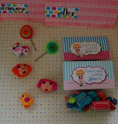 Party Favors - a button barrette  lalaloopsy pencil toppers {found at target}  and a bag of color coordinating candies