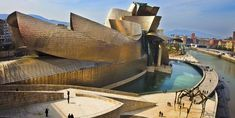 Renowned architect Frank Gehry is the brains behind the iconic Guggenheim Bilbao Museum, which houses three levels of modern and contemporary art. The structure continuously plays with curves, both on the inside and out Architecture Mode, Cultural Architecture, Beautiful Architecture, National Geographic, Spain Road Trip, Guggenheim Museum Bilbao, Basque Country, Global Art, New Art