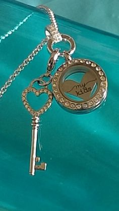 "Silver Mini Locket with our new clasp, the limited edition ""my kids"" heart and key dangle... https://www.facebook.com/pages/Origami-Owl-Jan-Elliott-Independent-Designer/521834807933844 janelliott.origamiowl.com"