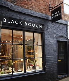 Store front, black painted bricks, Black Bough in London