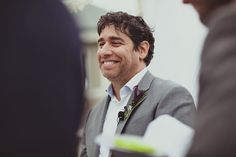 The groom dons a masculine boutonniere—a deep plum calla lily. De Young Flowers. IQphoto.