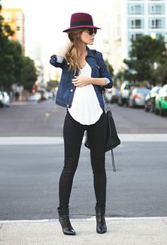 Perfect fall style with a denim jacket, classy fedora, and round sunglasses.