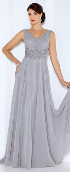Sleeveless chiffon A-line gown with front and back V-necklines, pleated bodice, hand-beaded motif wraps around natural waist, flyaway skirt with sweep train. Matching shawl included.