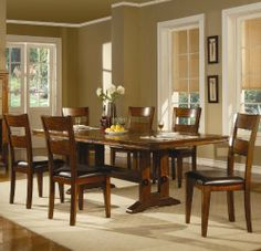 """7pc Dining Set with Metal Accents in Dark Oak Finish by Coaster Home Furnishings. $1215.15. You will receive a total of 1 dining table and 6 dining chairs. Table: 44""""W x 72""""L-90""""L x 30""""H. Chairs: 22""""W x 19""""D x 40""""H Seat Depth: 18"""". Finish: Dark Oak. Material: Hardwood Solids, Mango Veneers, Vinyl. 7pc Dining Set with Metal Accents in Dark Oak Finish. Intertwining a great mix of modern and classic styles, the transitional pieces blend beautifully with many home d..."""