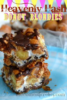 Heavenly Hash Donut Blondies * 5 EASY ingredients: donut holes * Hershey's Cookies & Cream candy bars * chocolate chip cookie dough * marshmallow fluff * canned chocolate frosting *** DECADENT !