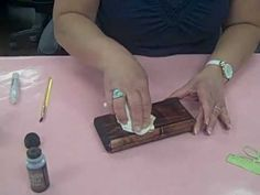 Video Demo of using Tim Holtz Distress Ink Stain on wood project, Sew Happy