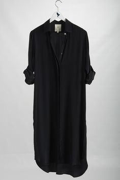 Shirt dress, with a black, wide belt would be fantastic.  http://www.halftee.com