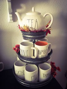 Rae Dunn Display Ideas To Make Beautiful Decor In Your Home 2106 Mug Display, Display Ideas, Ray Dunn, Coffee Bars In Kitchen, Mug Rack, Tiered Stand, Thing 1, Mud Pie, Tea Pots