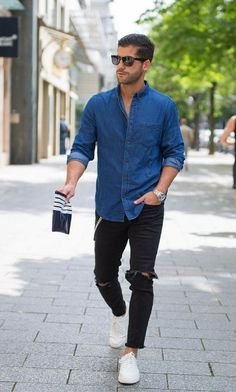 black ripped jeans, a chambray shirt and white sneakers