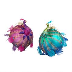Our brilliant peacocks boast gold beaks, glittering necks and distinctive tails that unfold over richly hued ball ornaments. Hand painted and embellished with sparkling sequins and real feathers, they bring majestic style to your tree. Peacock Christmas, Unique Christmas Ornaments, Christmas Tree Themes, Peacock Ornaments, Ball Ornaments, World Market Store, Eclectic Decor, Hand Painted, Peacocks