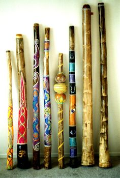 hand painted walking sticks. scrape off bark-let dry-paint then laquer