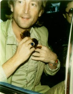 vintage everyday: These Candid Snapshots of John Lennon on the Streets Taken by Fans from the 1970s